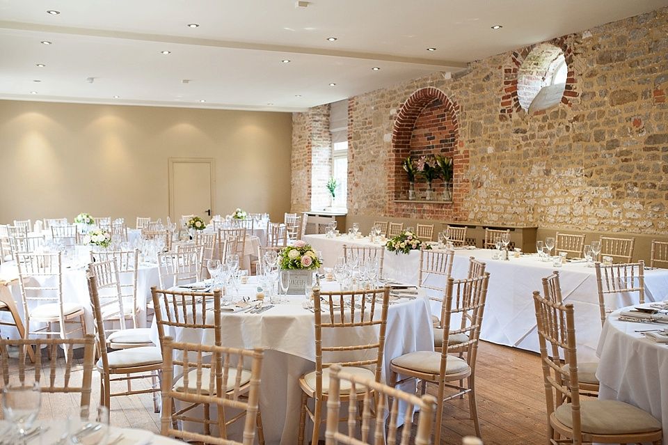 Rustic white table layout at an English country garden wedding at the Walled Garden at Cowdray Sussex - natural wedding photographer © Fiona Kelly photography