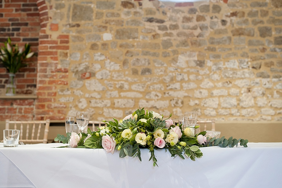 Top table wedding flowers by Blooms Florists at an English country garden wedding at the Walled Garden at Cowdray Sussex - natural wedding photographer © Fiona Kelly photography