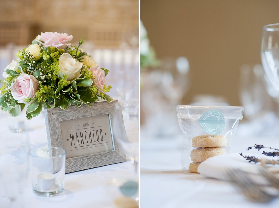 Pink and White Roses by Blooms Florist with photo frame and biscuit wedding favours at an English country garden wedding at the Walled Garden at Cowdray Sussex - natural wedding photographer © Fiona Kelly photography