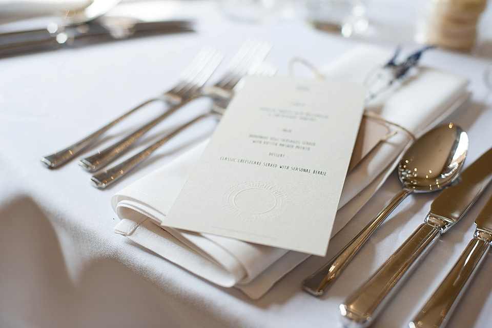 Menu on cream card at an English country garden wedding at the Walled Garden at Cowdray Sussex - natural wedding photographer © Fiona Kelly photography