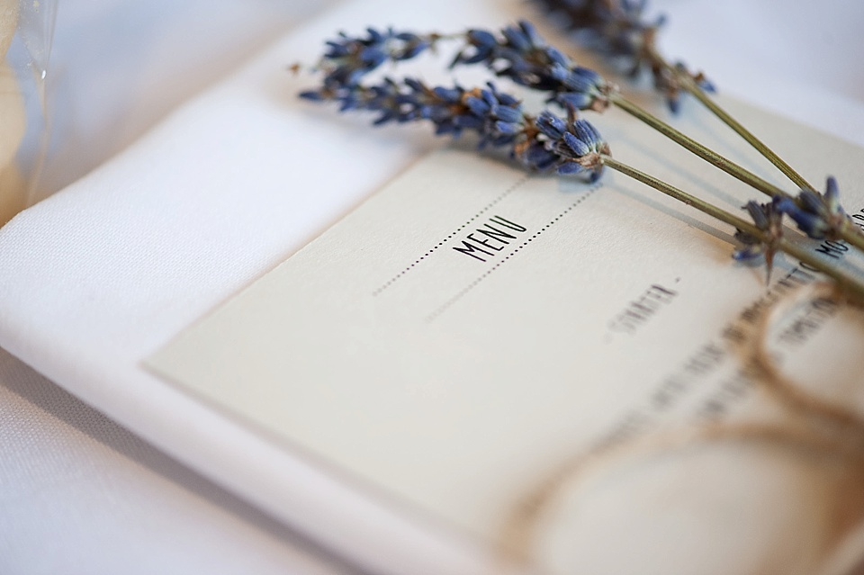 Lavender and menu on the table at an English country garden wedding at the Walled Garden at Cowdray Sussex - natural wedding photographer © Fiona Kelly photography