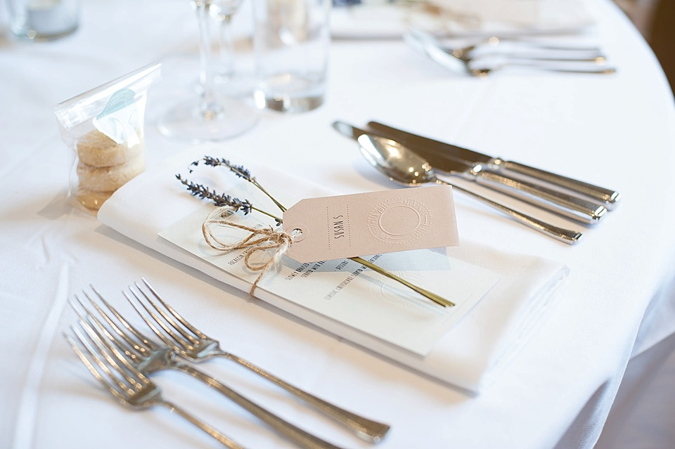 Biscuit and lavender favours on the table at an English country garden wedding at the Walled Garden at Cowdray Sussex - natural wedding photographer © Fiona Kelly photography