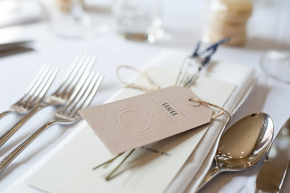 Table with silver cutlery and menu at an English country garden wedding at the Walled Garden at Cowdray Sussex - natural wedding photographer © Fiona Kelly photography