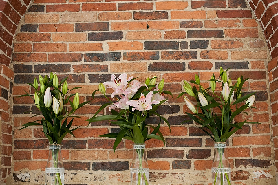 Beautiful pink Lilies by Blooms Florist at an English country garden wedding at the Walled Garden at Cowdray Sussex - natural wedding photographer © Fiona Kelly photography