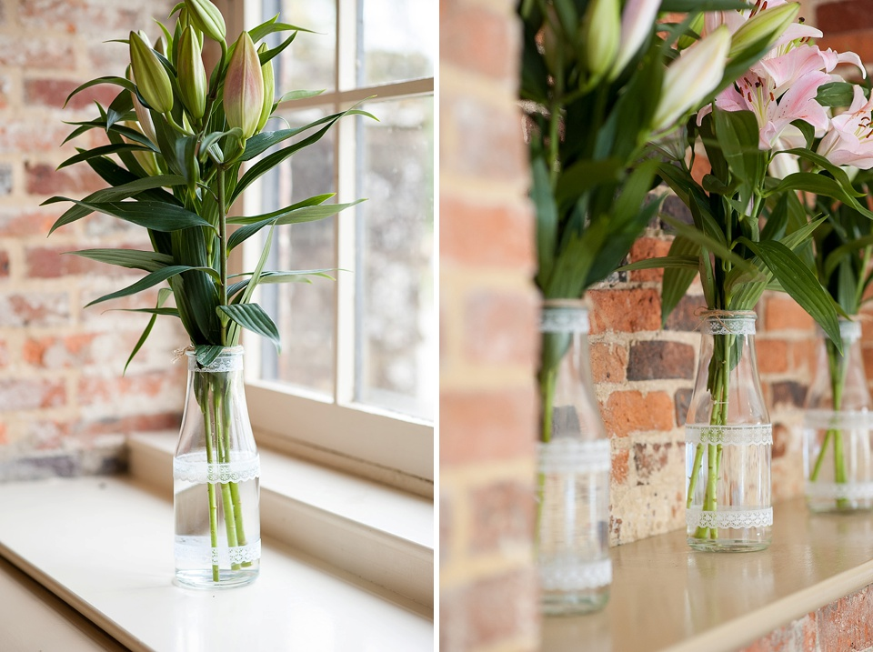 Lilies waiting to bloom by Blooms Florist at an English country garden wedding at the Walled Garden at Cowdray Sussex - natural wedding photographer © Fiona Kelly photography