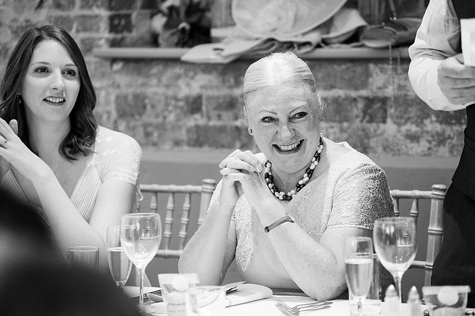 Bridesmaid with mother of the bride at English country garden wedding at the Walled Garden at Cowdray Sussex - natural wedding photographer © Fiona Kelly photography