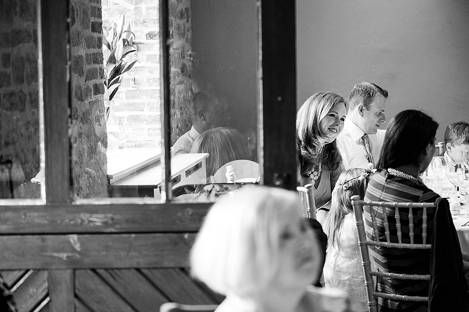 Wedding guests at English country garden wedding at the Walled Garden at Cowdray Sussex - natural wedding photographer © Fiona Kelly photography