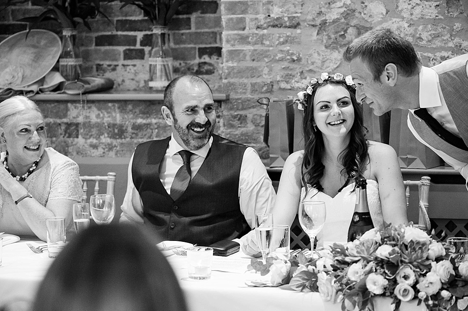 Groom talking to bride and parents at English country garden wedding at the Walled Garden at Cowdray Sussex - natural wedding photographer © Fiona Kelly photography
