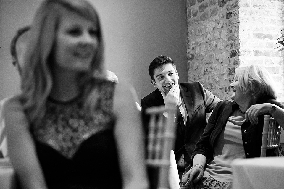 Laughing during speeches - English country garden wedding at the Walled Garden at Cowdray Sussex - natural wedding photographer © Fiona Kelly photography