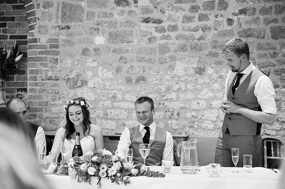 Best Man embarrasses groom in speech at English country garden wedding at the Walled Garden at Cowdray Sussex - natural wedding photographer © Fiona Kelly photography