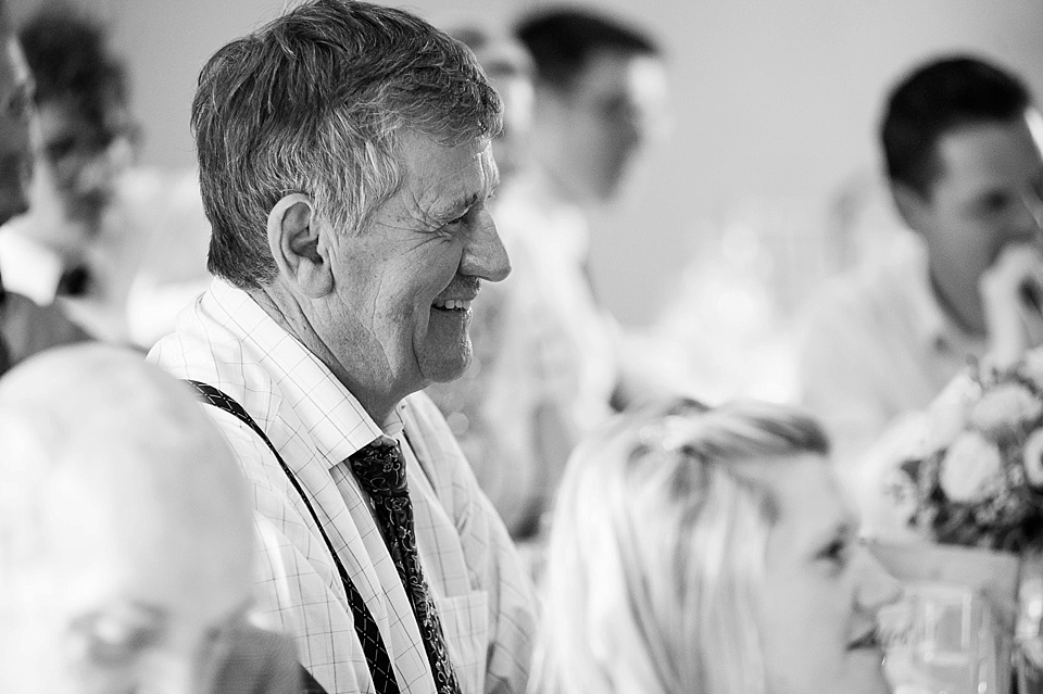 Smiling wedding guest - English country garden wedding at the Walled Garden at Cowdray Sussex - natural wedding photographer © Fiona Kelly photography