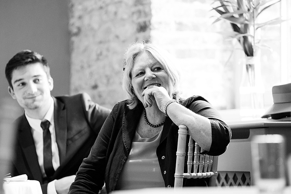 Listening to the speeches - English country garden wedding at the Walled Garden at Cowdray Sussex - natural wedding photographer © Fiona Kelly photography