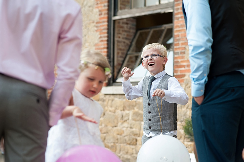 Children playing with balloons English country garden wedding at the Walled Garden at Cowdray Sussex - natural wedding photographer © Fiona Kelly photography