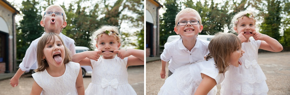 Page boy and flower girls pulling faces at English country garden wedding at the Walled Garden at Cowdray Sussex - natural wedding photographer © Fiona Kelly photography