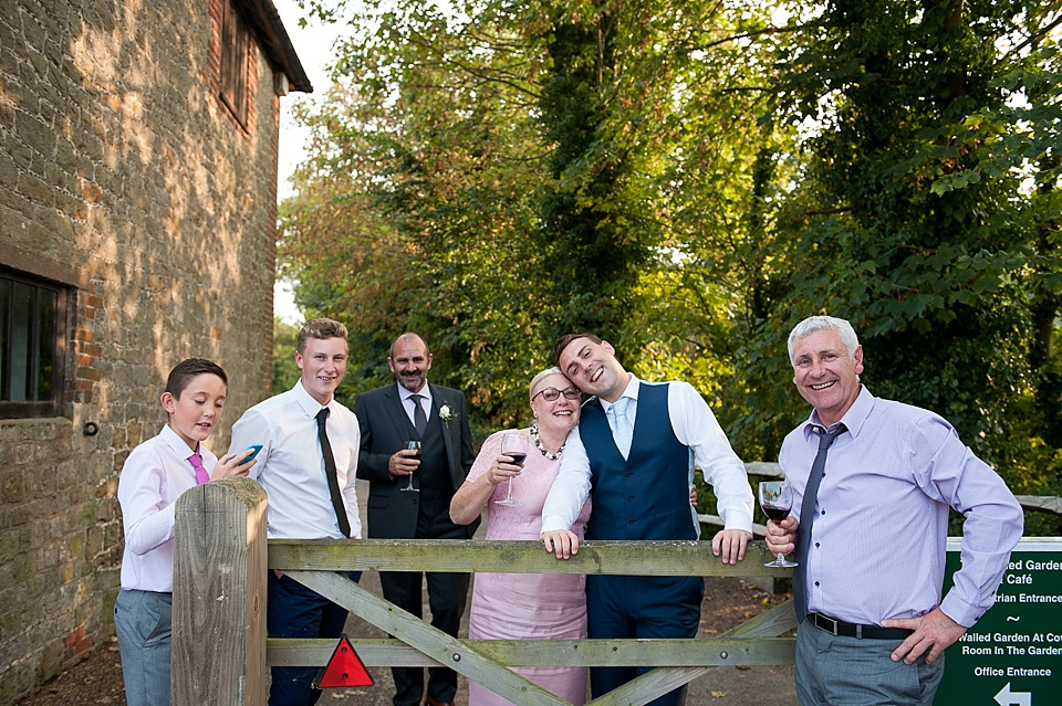 Family photo at English country garden wedding at the Walled Garden at Cowdray Sussex - natural wedding photographer © Fiona Kelly photography