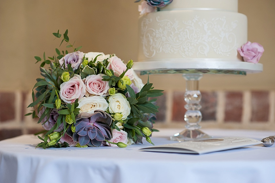Flowers by Blooms - soft pink and succulents with wedding cake by Mrs Robinson's cakes - English country garden wedding at the Walled Garden at Cowdray Sussex - natural wedding photographer © Fiona Kelly photography
