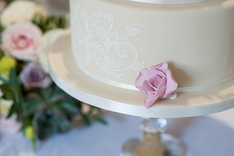 Detail on white wedding cake by Mrs Robinson's Cakes at English country garden wedding at the Walled Garden at Cowdray Sussex - natural wedding photographer © Fiona Kelly photography