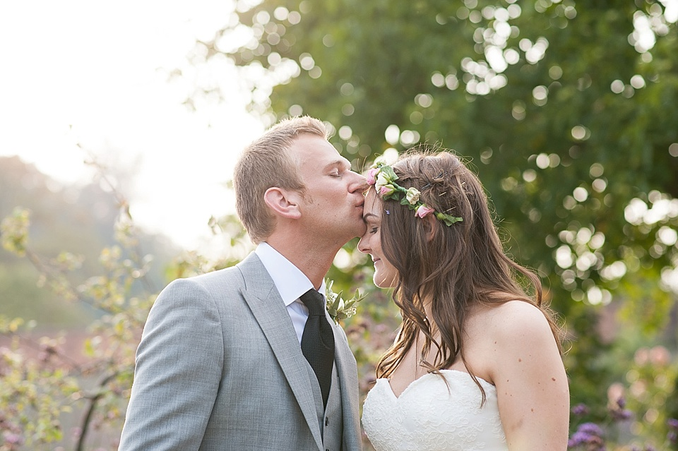 Intimate wedding portrait in the garden at English country garden wedding at the Walled Garden at Cowdray Sussex - natural wedding photographer © Fiona Kelly photography