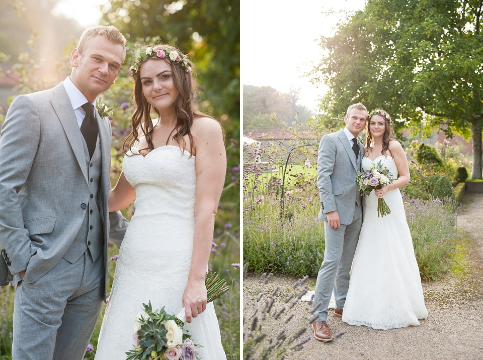 Bride wearing lace wedding dress and real flower crown with groom at English country garden wedding at the Walled Garden at Cowdray Sussex - natural wedding photographer © Fiona Kelly photography