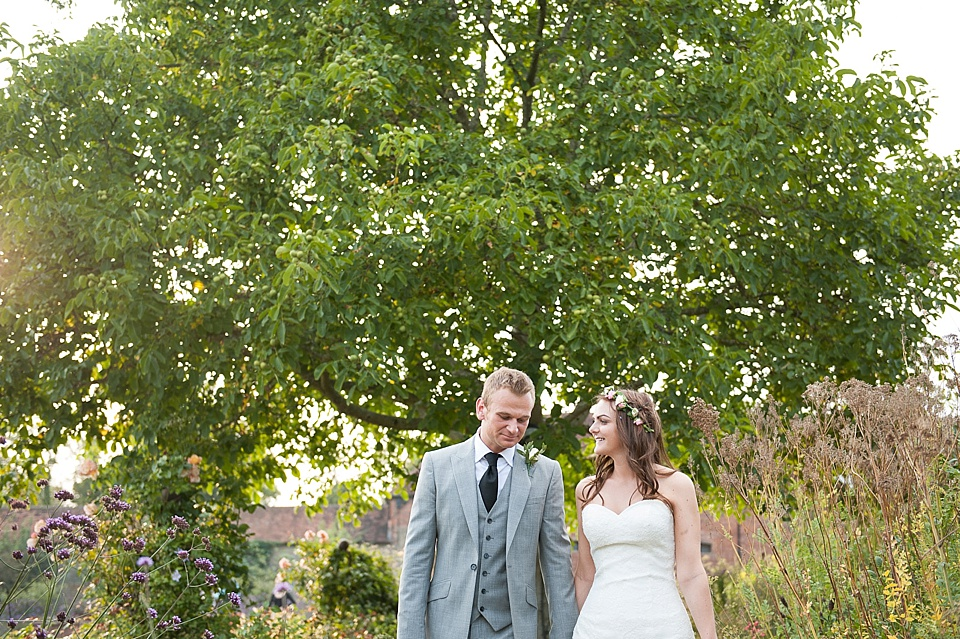 Bride in Lillian West dress and groom at English country garden wedding at the Walled Garden at Cowdray Sussex - natural wedding photographer © Fiona Kelly photography