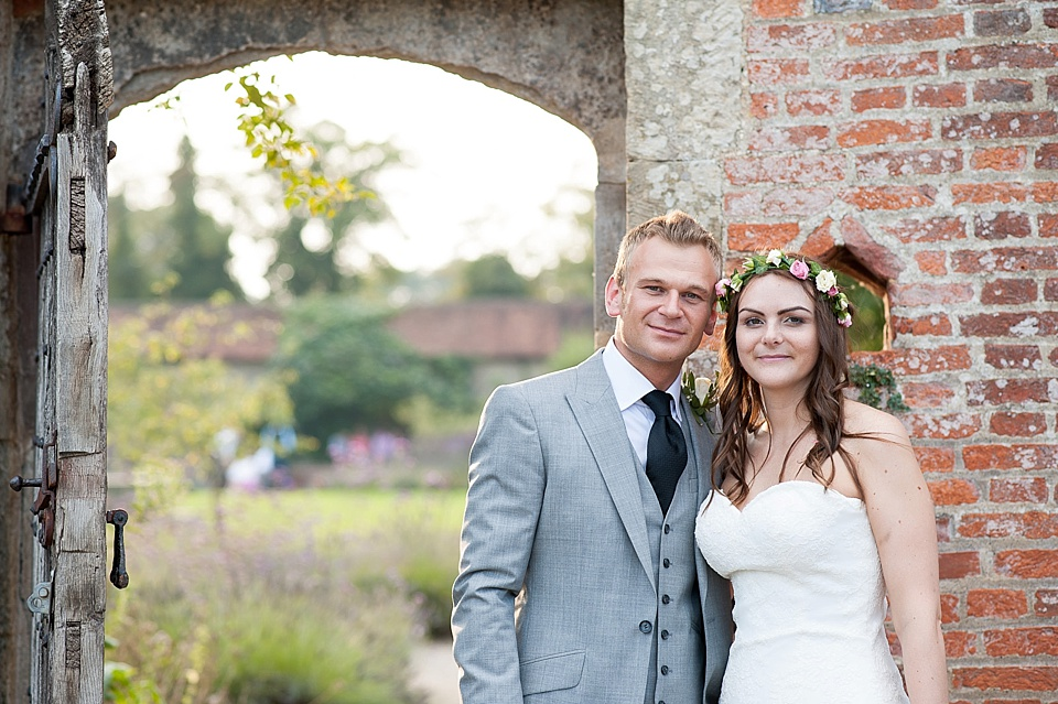 Wedding portrait with bride wearing flower crown at English country garden wedding at the Walled Garden at Cowdray Sussex - natural wedding photographer © Fiona Kelly photography