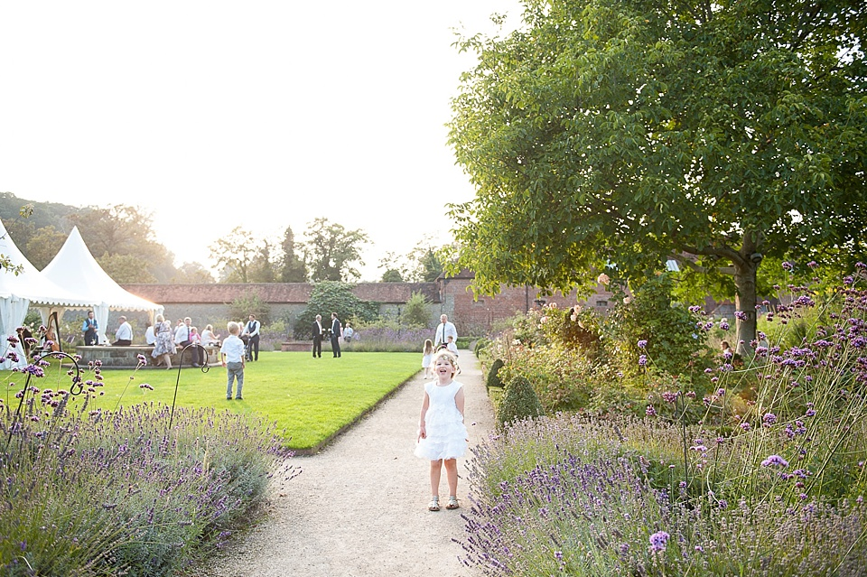 Children playing in beautiful setting - English country garden wedding at the Walled Garden at Cowdray - Sussex wedding photographer © Fiona Kelly photography
