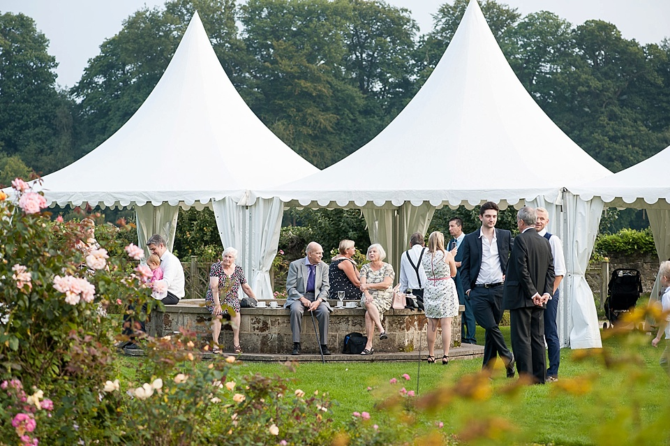 Drinks reception in beautiful setting - English country garden wedding at the Walled Garden at Cowdray - Sussex wedding photographer © Fiona Kelly photography