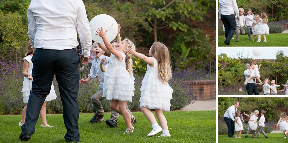 flower girls and page boys playing at English country garden wedding at the Walled Garden at Cowdray - Sussex wedding photographer © Fiona Kelly photography
