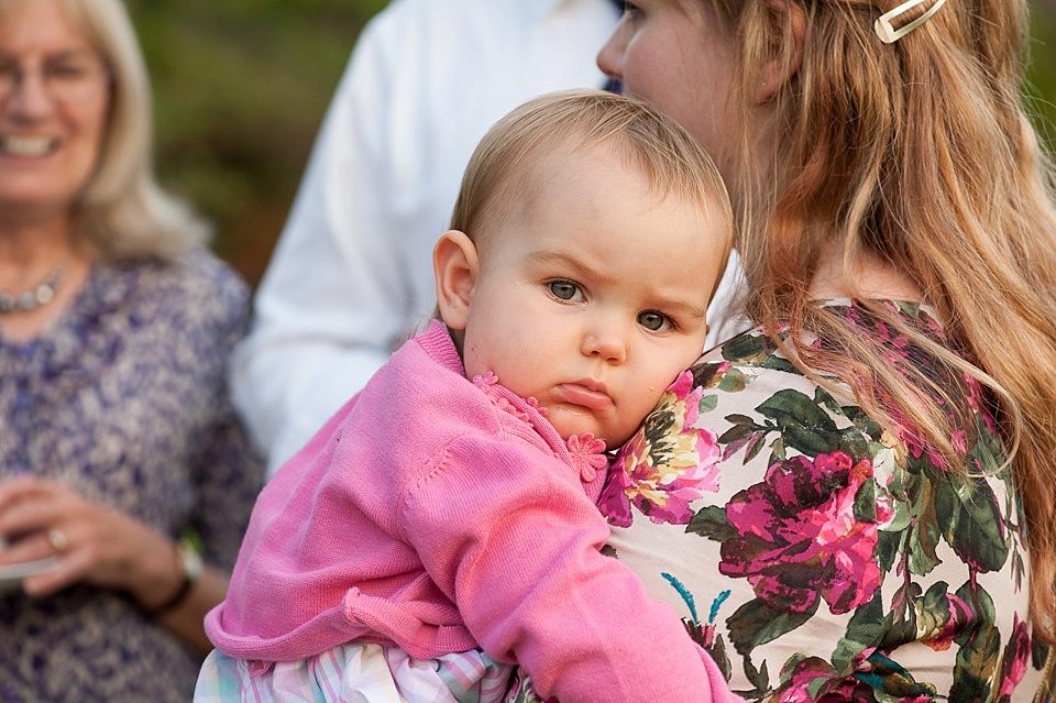 Baby in pink at English country garden wedding at the Walled Garden at Cowdray - Sussex wedding photographer © Fiona Kelly photography