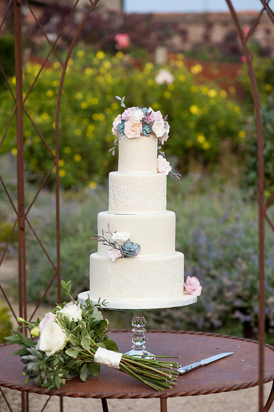Cake by Mrs Robinson's Cakes and flowers by Blooms - English country garden wedding at the Walled Garden at Cowdray - Sussex wedding photographer © Fiona Kelly photography