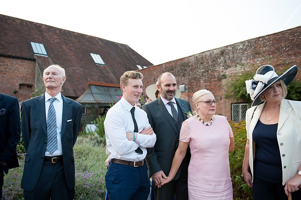 Bride's family watching English country garden wedding at the Walled Garden at Cowdray - Sussex wedding photographer © Fiona Kelly photography