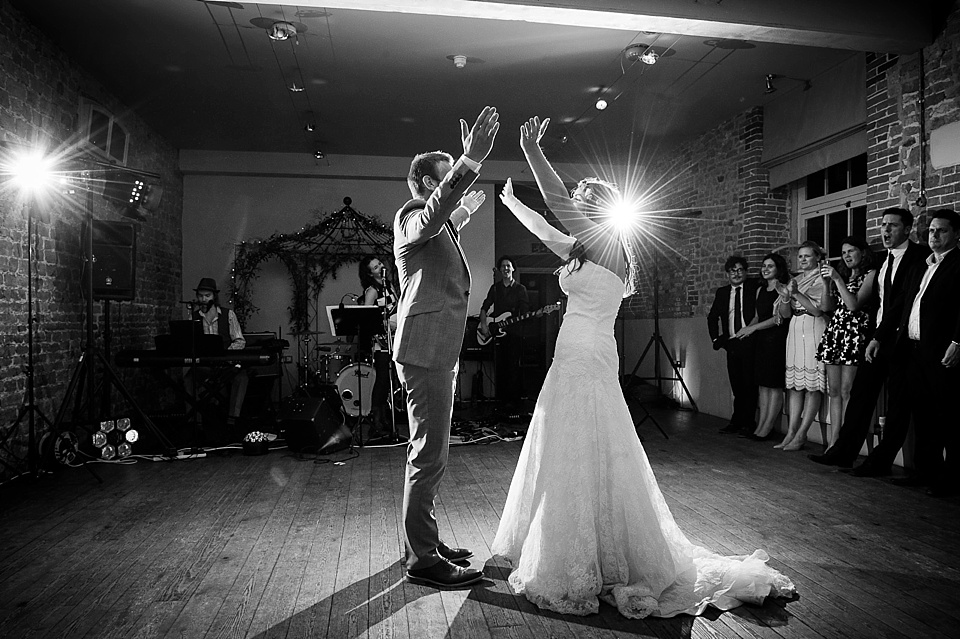Bride in Lillian West lace wedding gown dancing first dance with groom English country garden wedding at the Walled Garden at Cowdray Sussex - natural wedding photographer © Fiona Kelly photography