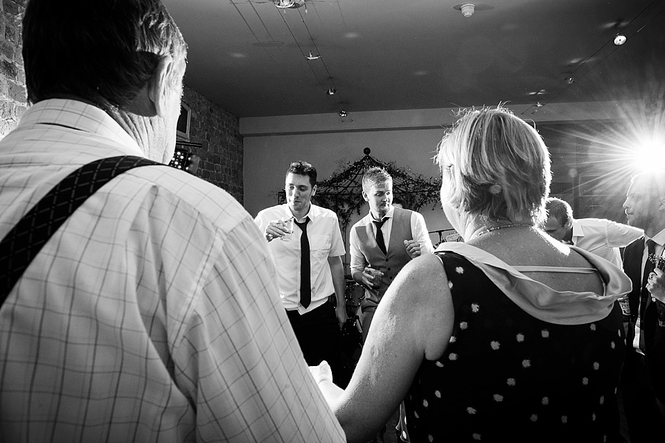 Over the shoulder dance floor English country garden wedding at the Walled Garden at Cowdray Sussex - natural wedding photographer © Fiona Kelly photography
