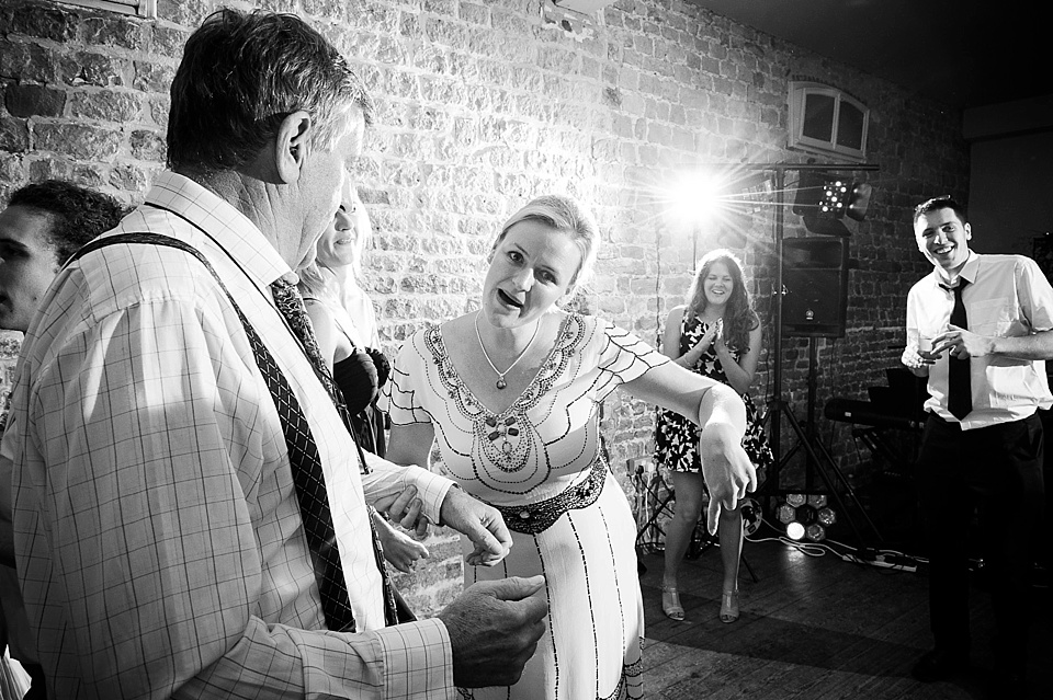 Wedding guest silly dancing English country garden wedding at the Walled Garden at Cowdray Sussex - natural wedding photographer © Fiona Kelly photography