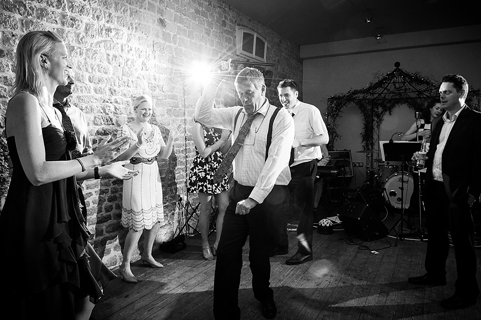 Dancefloor antics English country garden wedding at the Walled Garden at Cowdray Sussex - natural wedding photographer © Fiona Kelly photography