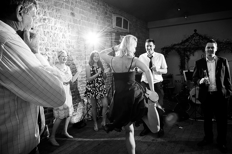 Silly dancing at English country garden wedding at the Walled Garden at Cowdray Sussex - natural wedding photographer © Fiona Kelly photography