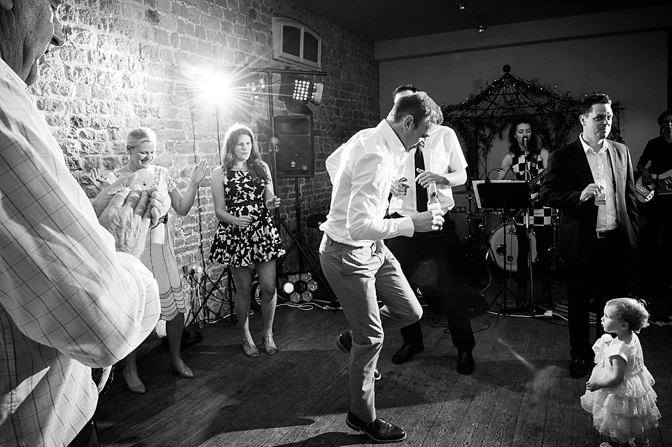 Groom on the dance floor at English country garden wedding at the Walled Garden at Cowdray Sussex - natural wedding photographer © Fiona Kelly photography