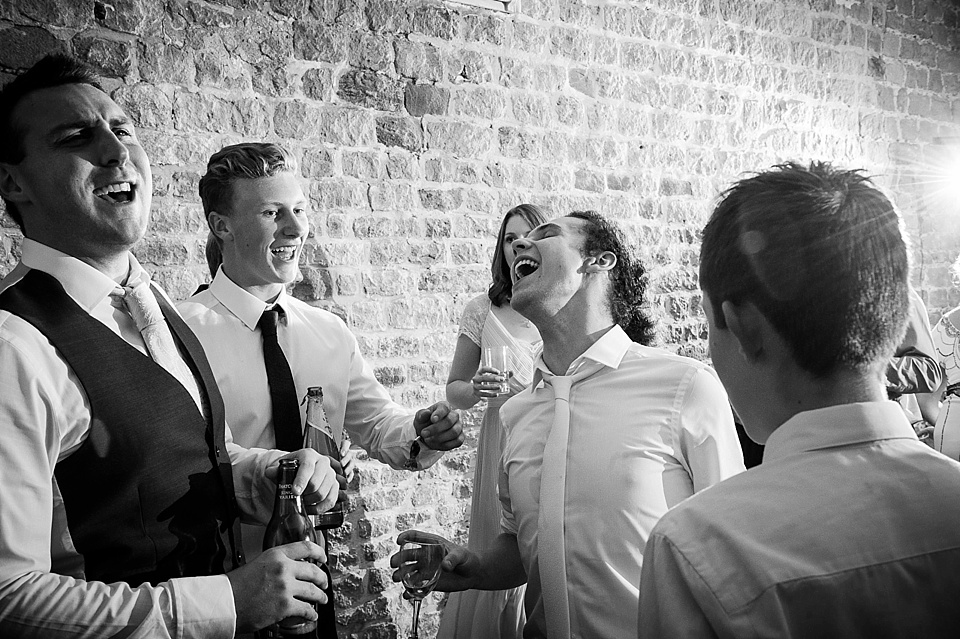 Fun and laughter at English country garden wedding at the Walled Garden at Cowdray Sussex - natural wedding photographer © Fiona Kelly photography