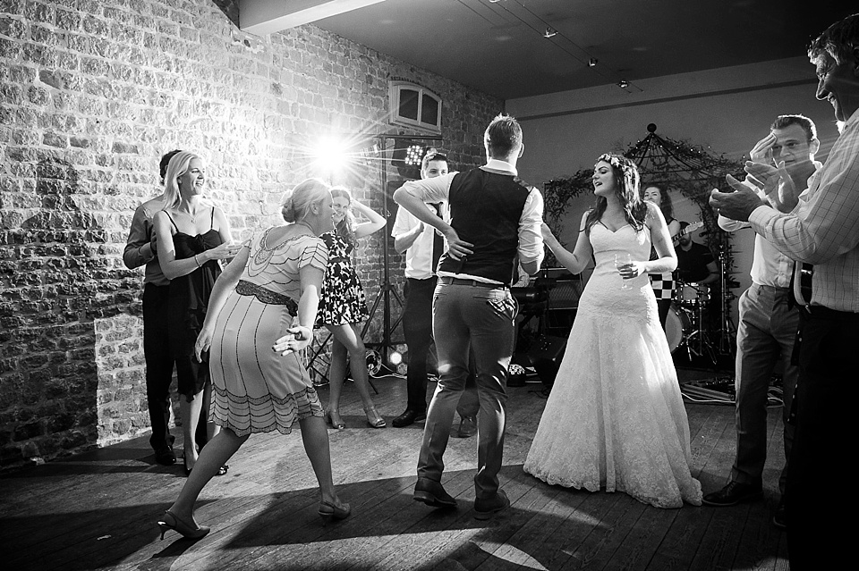 Bride in Lillian West wedding dress dancing with friends English country garden wedding at the Walled Garden at Cowdray Sussex - natural wedding photographer © Fiona Kelly photography