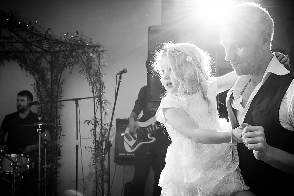 Flower girl dancing with daddy at English country garden wedding at the Walled Garden at Cowdray Sussex - natural wedding photographer © Fiona Kelly photography