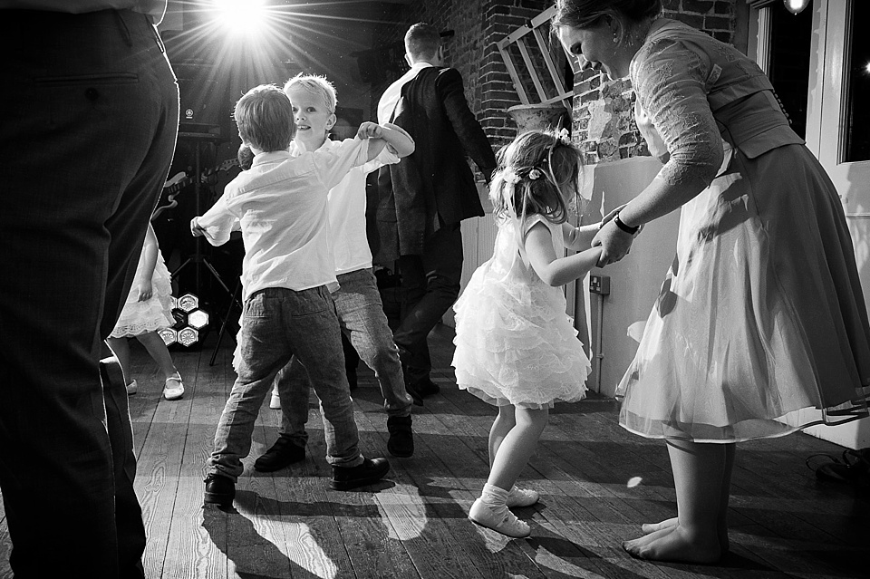 Flower girls and pageboys dancing at English country garden wedding at the Walled Garden at Cowdray Sussex - natural wedding photographer © Fiona Kelly photography