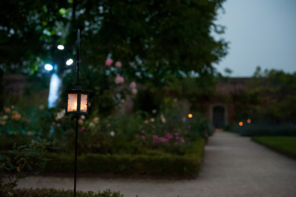 Garden is lit up - English country garden wedding at the Walled Garden at Cowdray Sussex - natural wedding photographer © Fiona Kelly photography