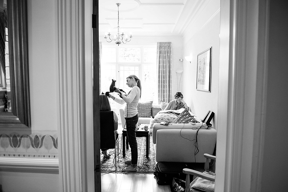 hairdresser styling hair, with lady reading a newspaper, thames rowing club wedding, a handmade wedding, scottish wedding photography © Fiona Kelly Photography