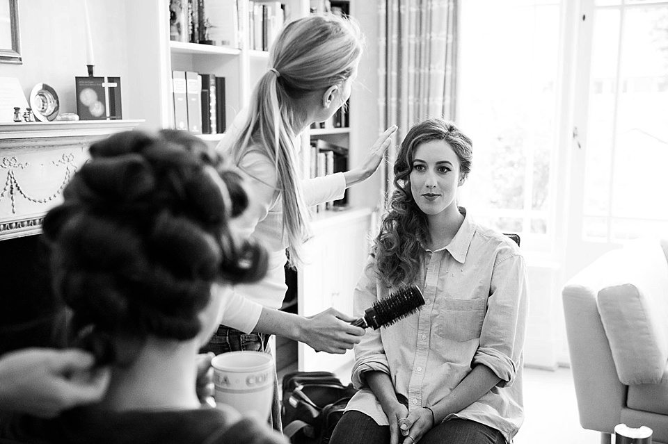 ladies having their hair curled and styled at a thames rowing club wedding, a handmade wedding, scottish wedding photographer © Fiona Kelly Photography