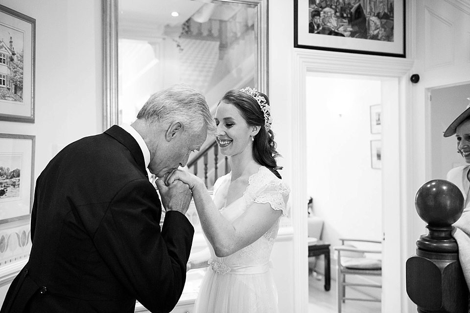 father of the bride kissing hand of his daughter the bride at a thames rowing club wedding, handmade wedding, scottish wedding photographer © Fiona Kelly Photography