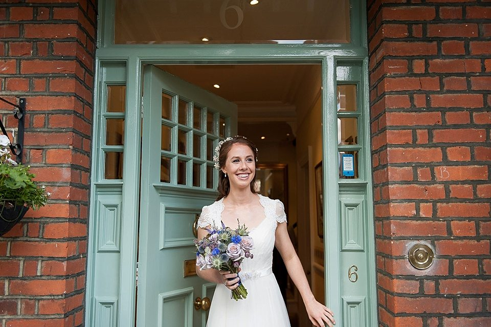 smiling bride leaving the house for the church at a thames rowing club wedding, a handmade wedding, scottish wedding photographer © Fiona Kelly Photography