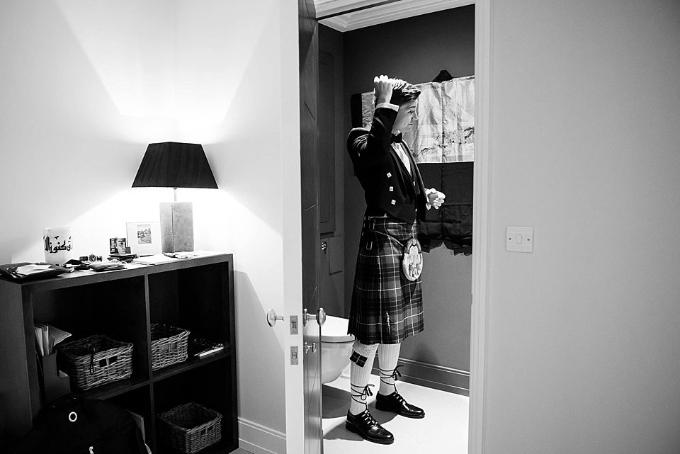 groom nearly ready at home pre-wedding at a thames rowing club wedding, a handmade wedding, scottish wedding photographer © Fiona Kelly Photography