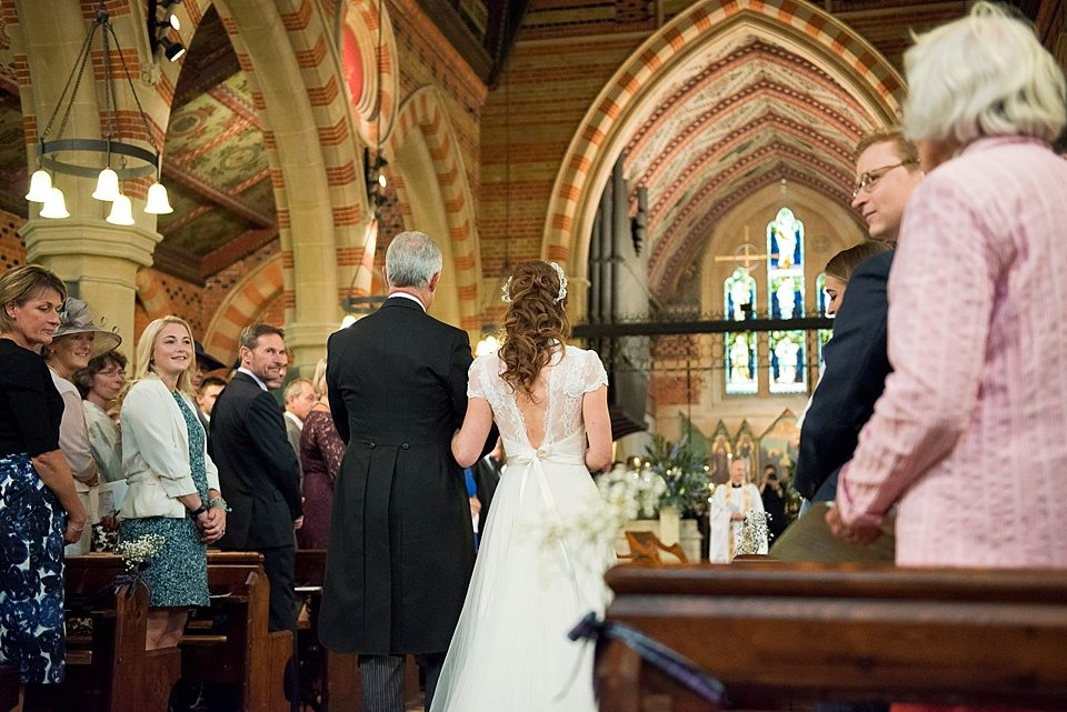 back of father of the bride and bride walking down the church aisle at a thames rowing club wedding, a handmade wedding, scottish wedding photographer © Fiona Kelly Photography