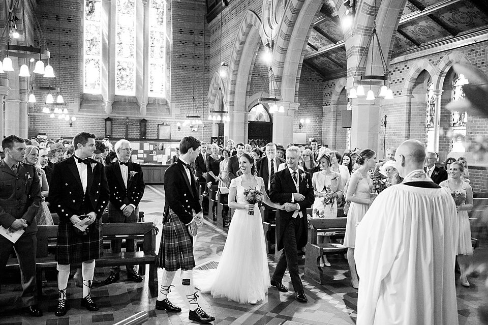bride arrives in church next to groom at a thames rowing club wedding, a handmade wedding, scottish wedding photographer © Fiona Kelly Photography