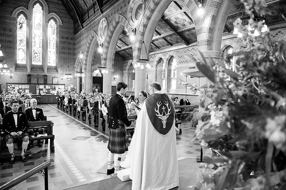 black and white shot of bride and couple saying vows at a thames rowing club wedding, a handmade wedding, scottish wedding photographer © Fiona Kelly Photography